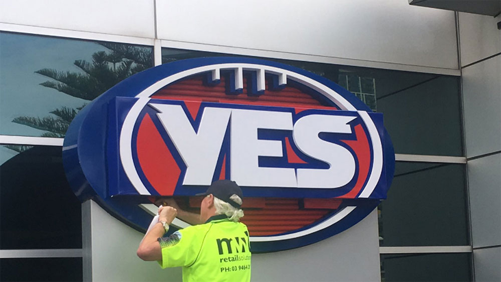 "AFL changes logo to ""YES"" outside headquarters"