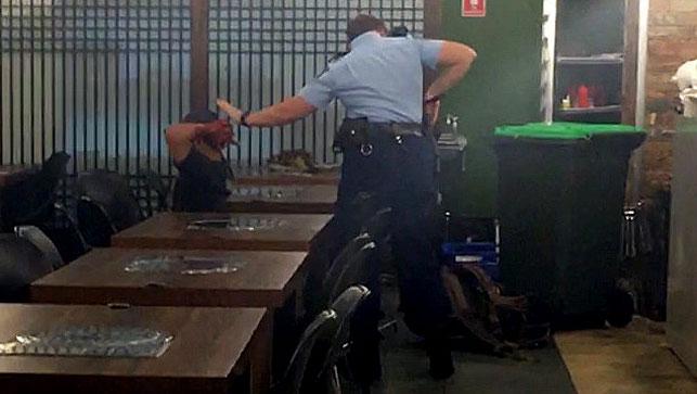 Alexander Villaluna being arrested in the Horsby restaurant in March last year. (AAP)