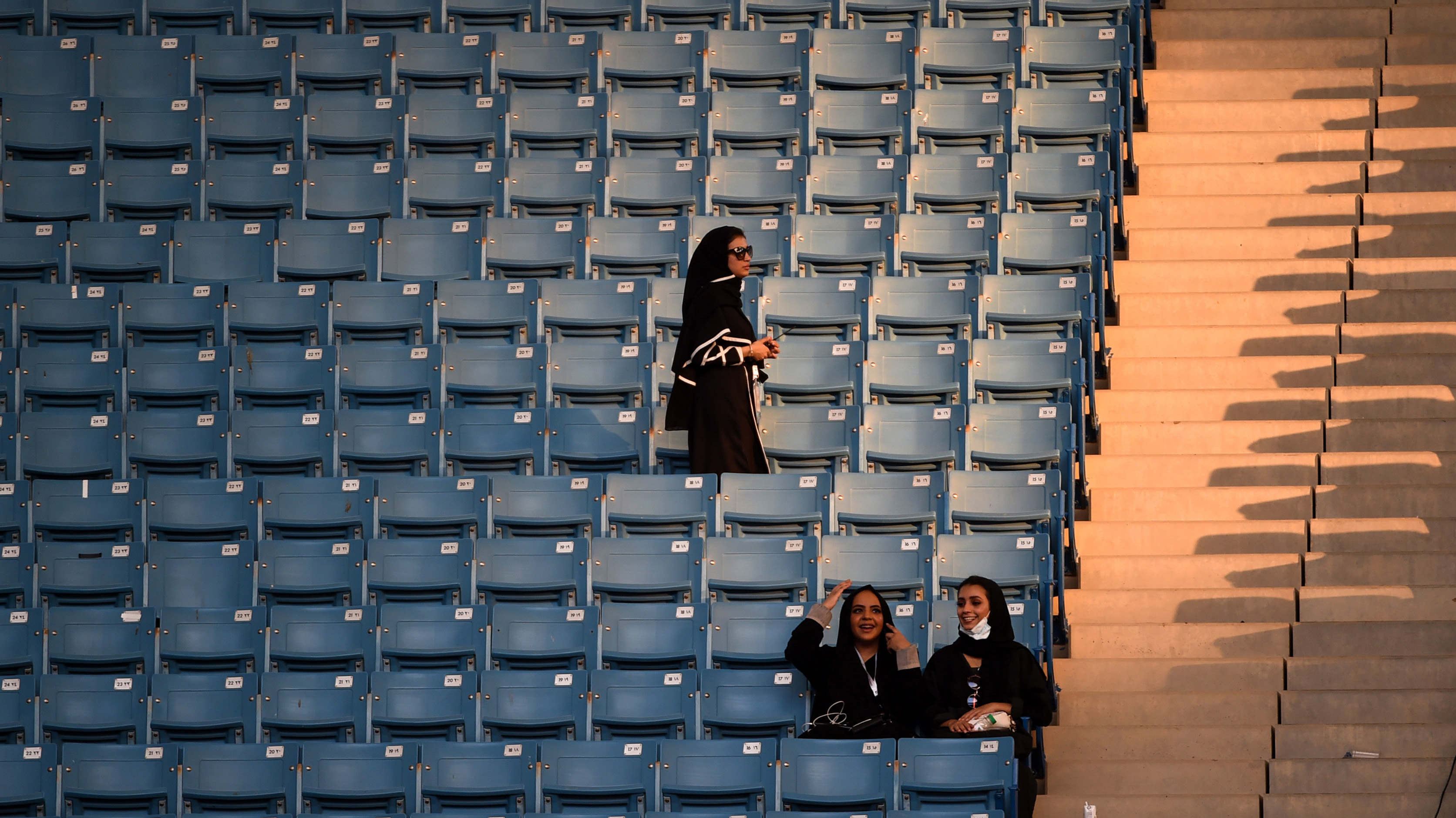 Women were allowed to enter the stadium, a previously male-only venue used mostly for football matches, with their families and seated separately from single men. (AFP)