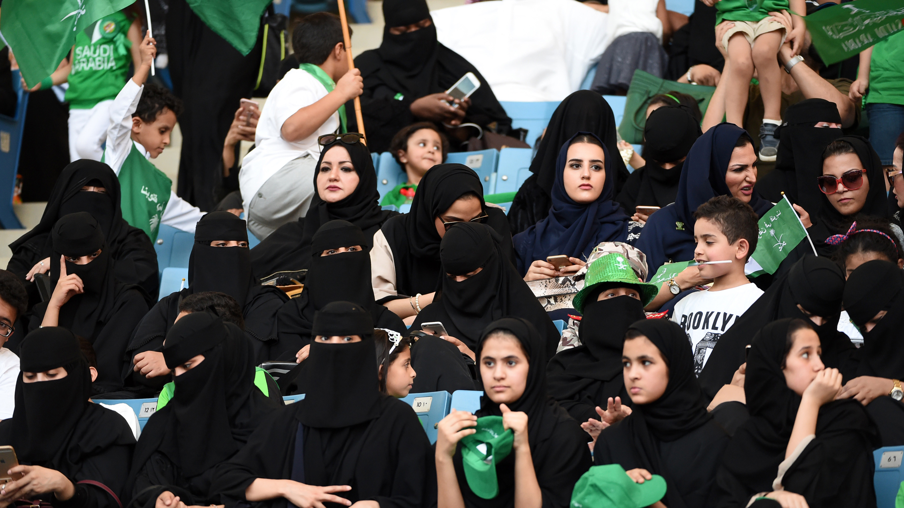 Saudi women turn out for national celebration in historic first