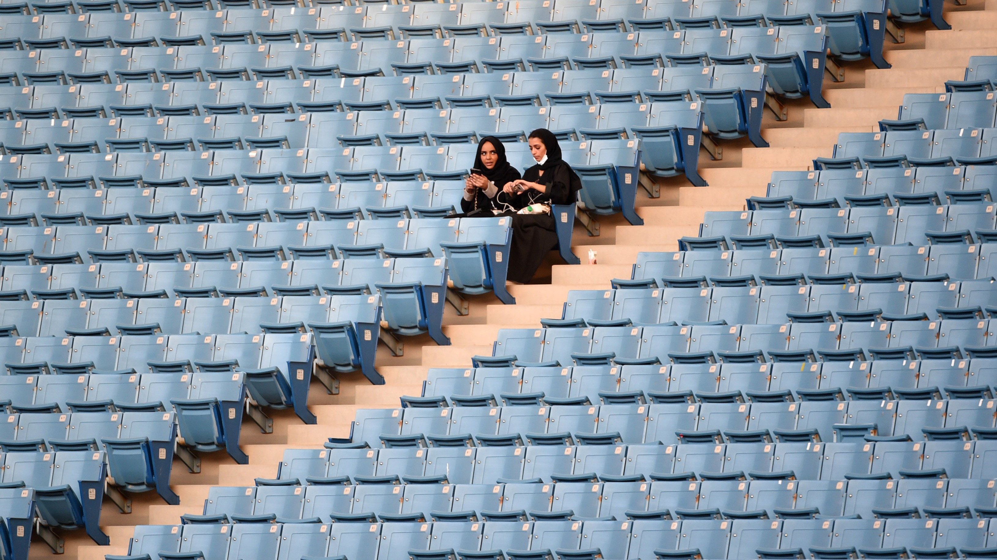 The presence of women at the King Fahd stadium marks a departure from previous celebrations in the Gulf kingdom. (AFP)