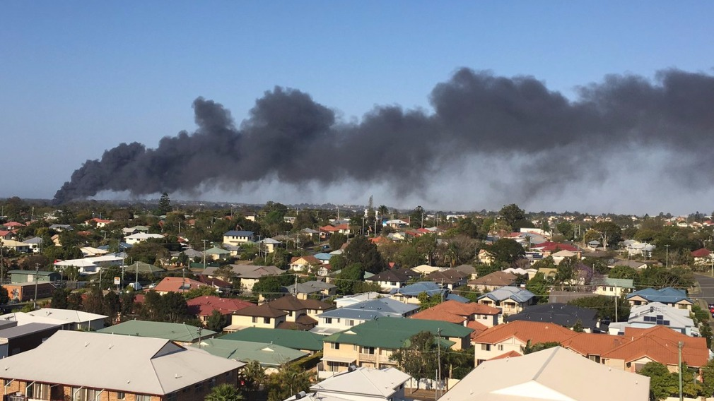 Fire engulfs businesses on Sandgate Rd, Police declare emergency situation