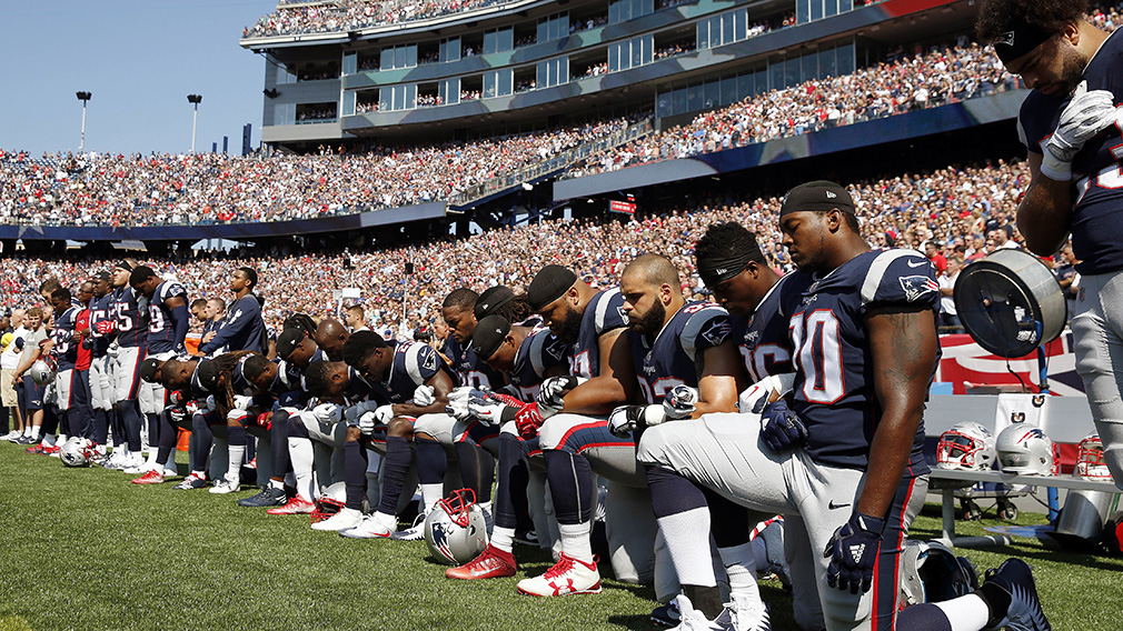 More than 100 NFL players kneel for US anthem in protest