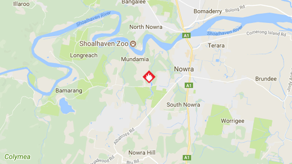 Out-of-control bushfire threatening properties near Nowra on NSW south coast