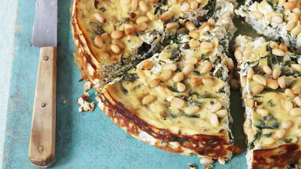 """<a href=""""http://kitchen.nine.com.au/2016/05/20/10/41/anjum-anands-baked-ricotta-with-chard"""" target=""""_top"""">Anjum Anand's baked ricotta with chard</a>"""