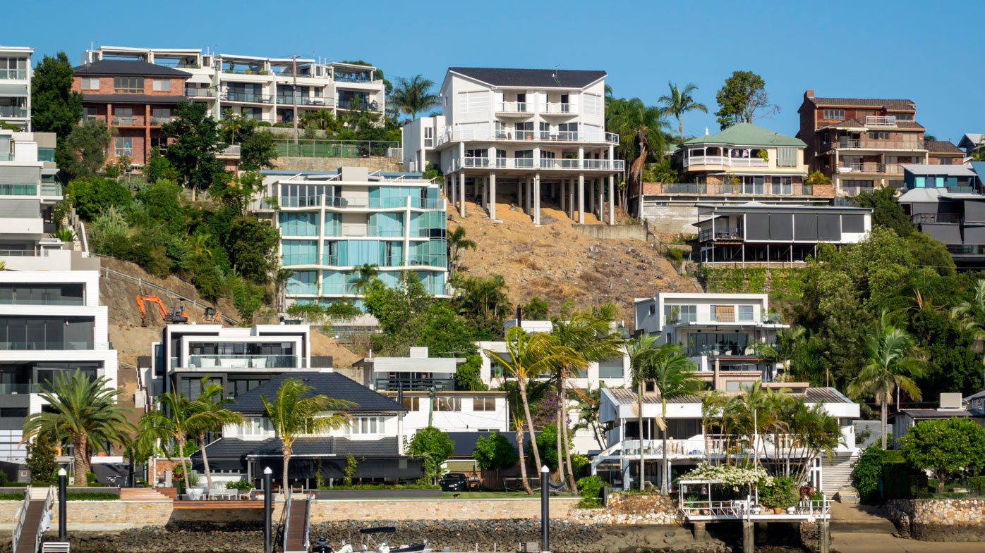Houses along the Brisbane River (Photo by: Jeff Greenberg/UIG via Getty Images)