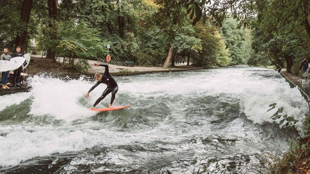Mick Fanning surfs the Eisbach River in Munich.