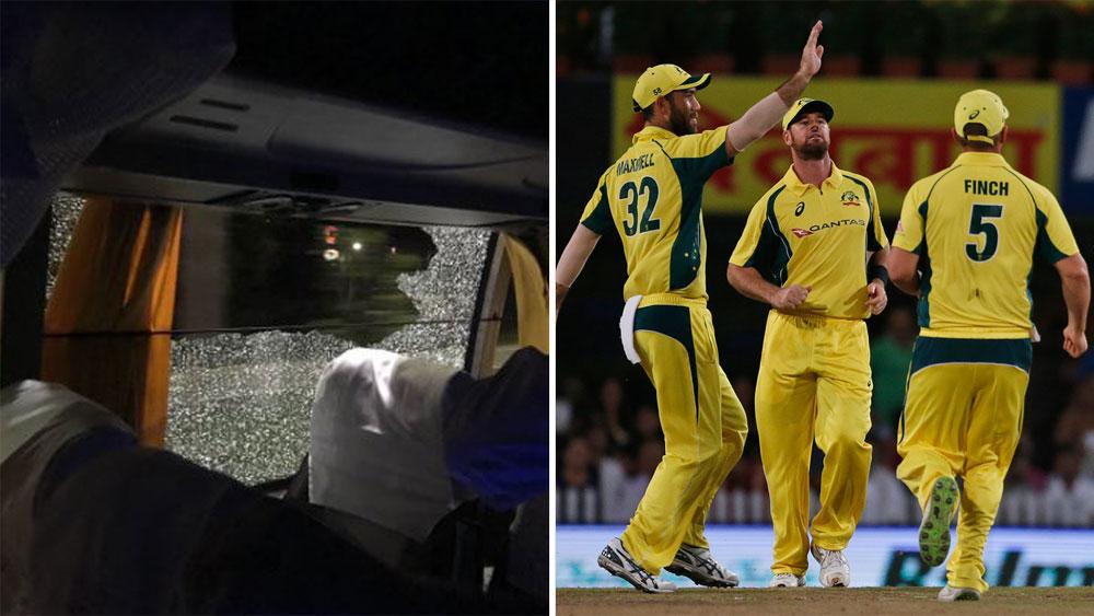 Rock shatters Australia cricket team's bus window.