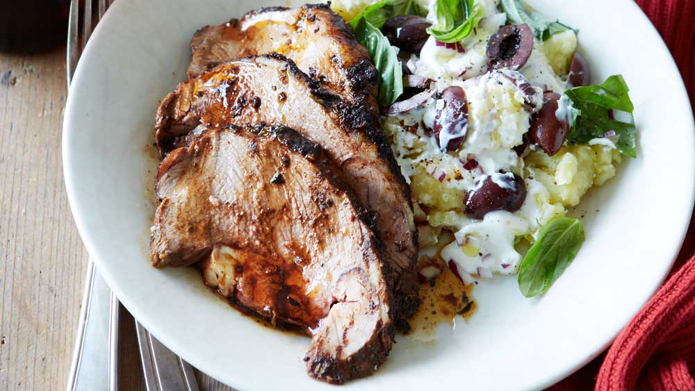 Boneless lamb shoulder roast with crushed kipflers recipe