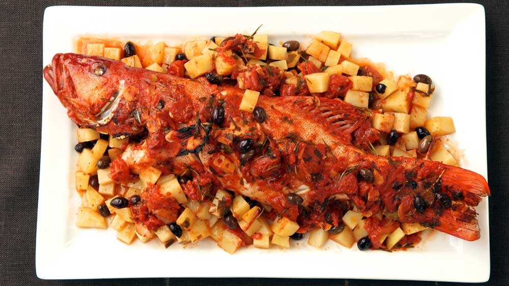 "Recipe: <a href=""https://kitchen.nine.com.au/2016/12/13/13/09/baked-whole-coral-trout-with-potato-and-tomato"" target=""_top"">Baked whole coral trout with potato and tomato</a>"