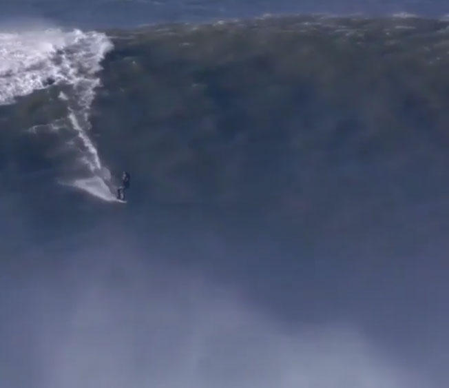 Big-wave surfer Andrew Cotton suffers broken back from Nazaré wipeout; video