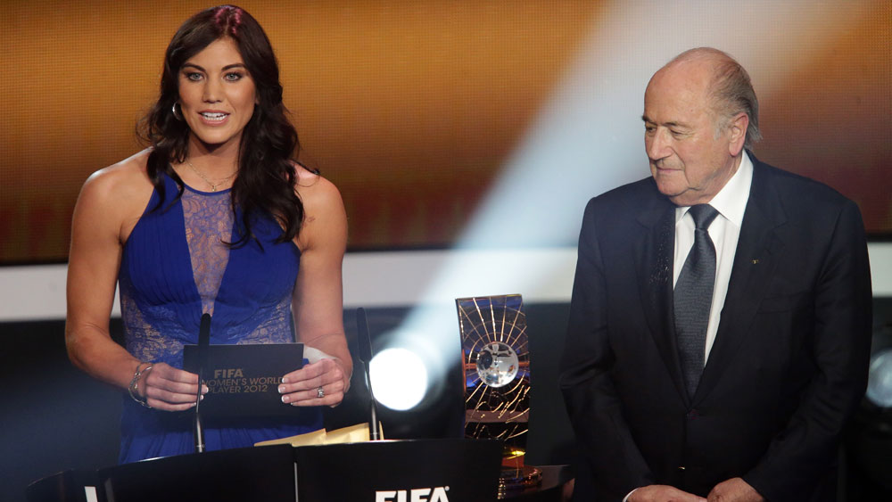 Hope Solo and Sepp Blatter.