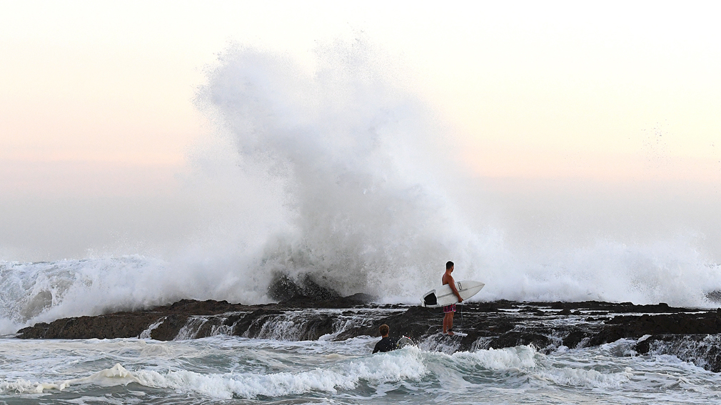 Scorching heat set to return today after day of wild surf