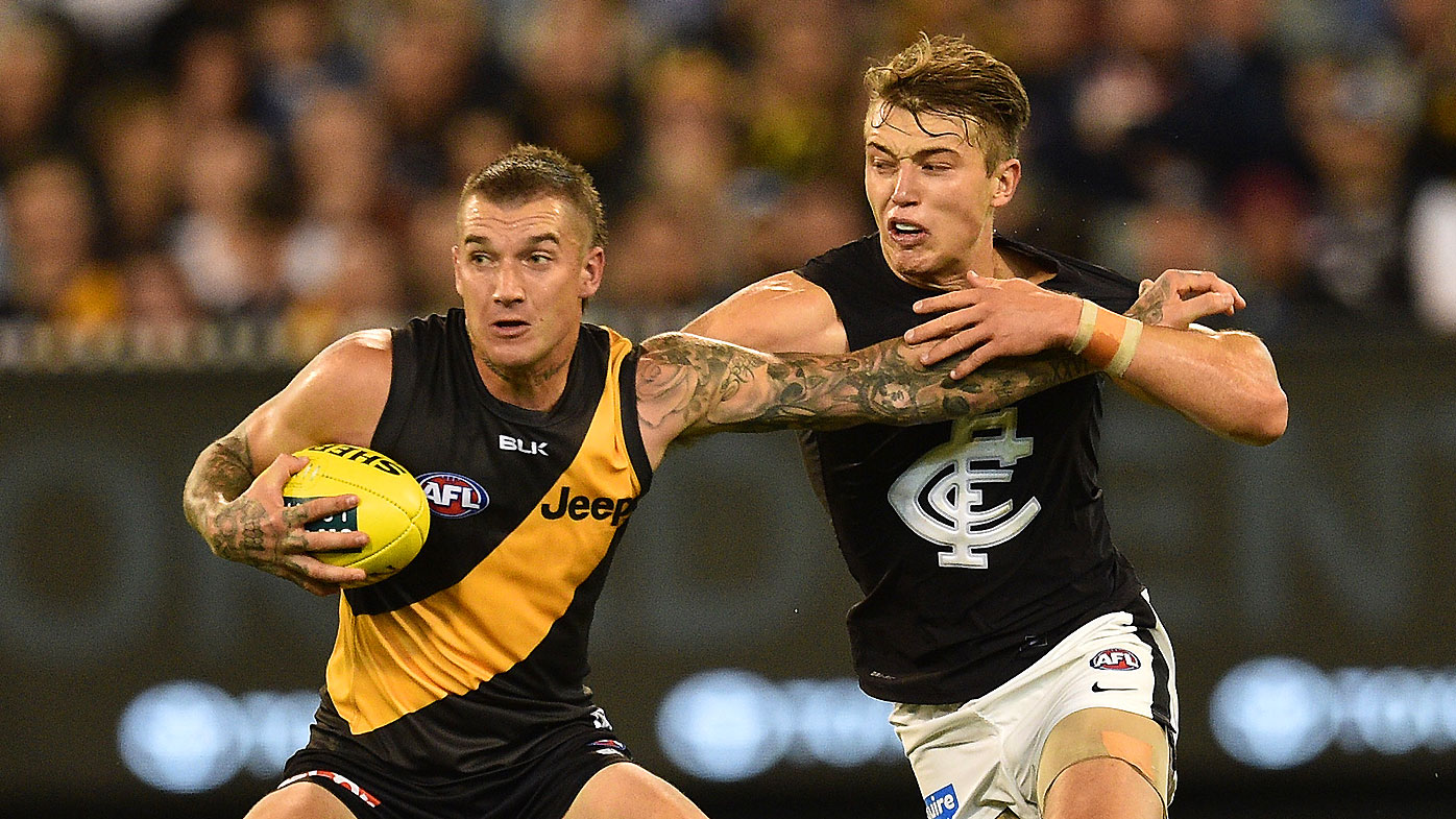 Richmond Tigers player Dustin Martin and Carlton Blues Patrick Cripps contest the ball