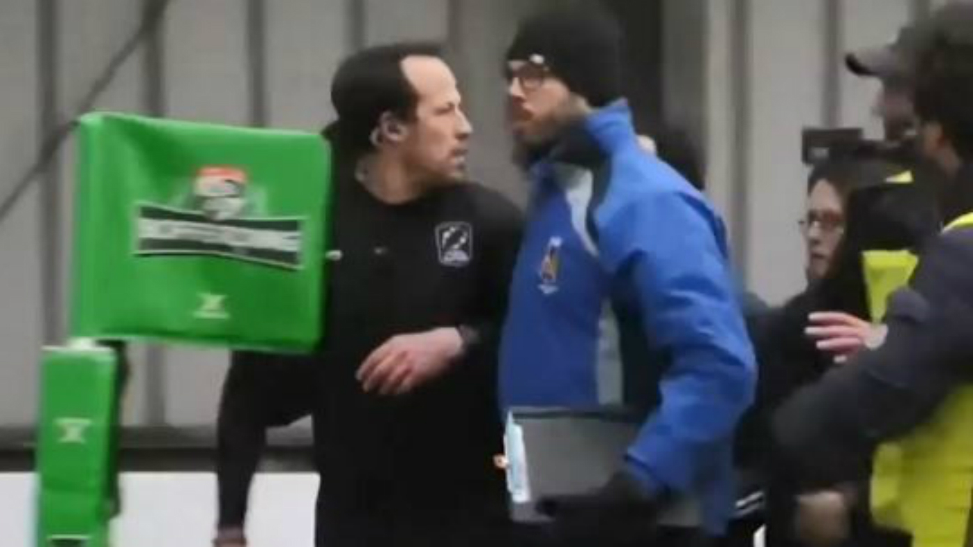 Referee is escorted