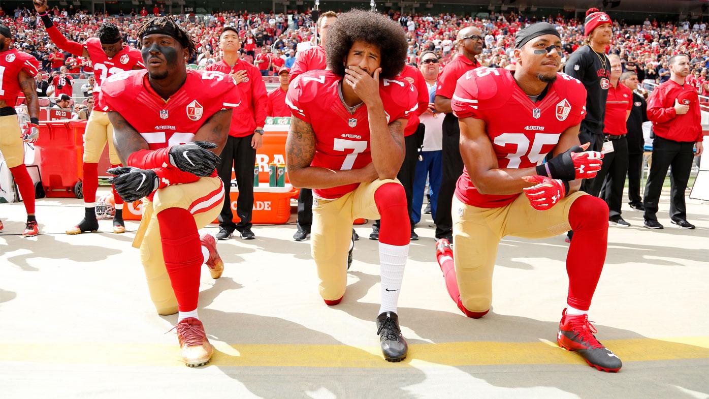 Kaeprnick kneels with teammates