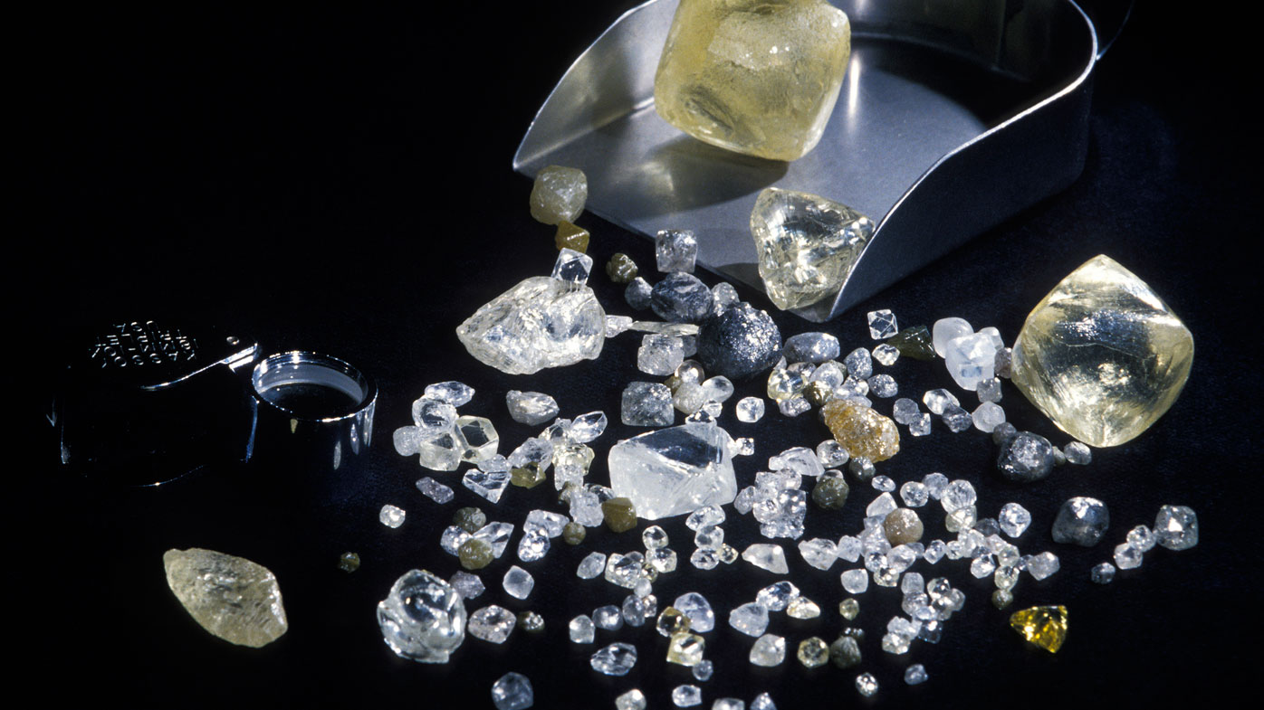 Some rough diamonds of varying carats, clarity, colour and form, at the Diamond Trading Company in London. (Photo by Patrick Landmann/Getty Images)
