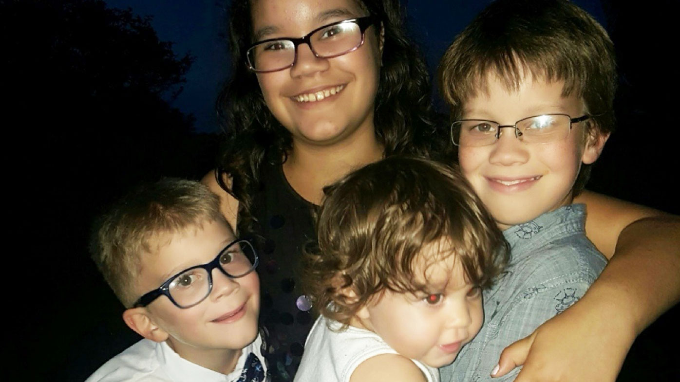 US community reeling after four children slain in suspected murder-suicide