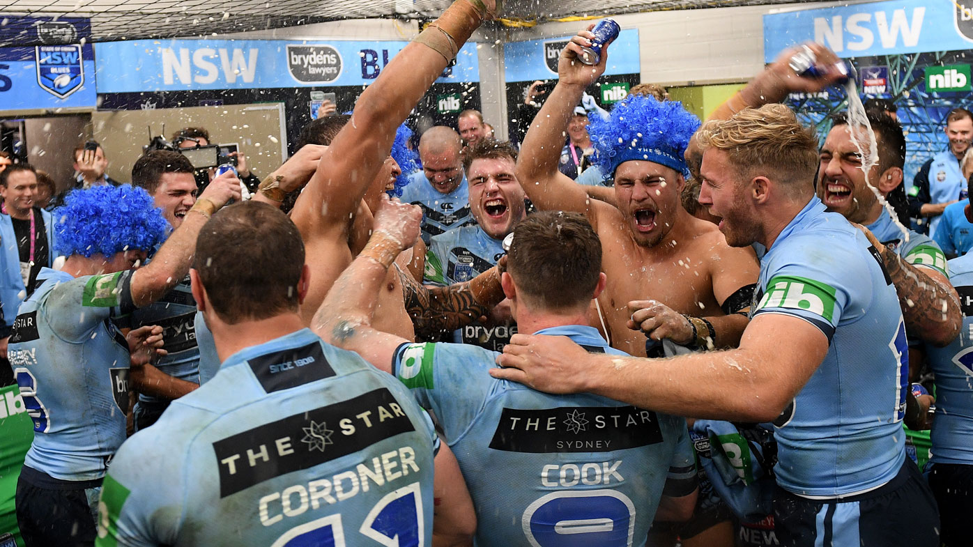 The NSW Blues celebrate Origin victory.