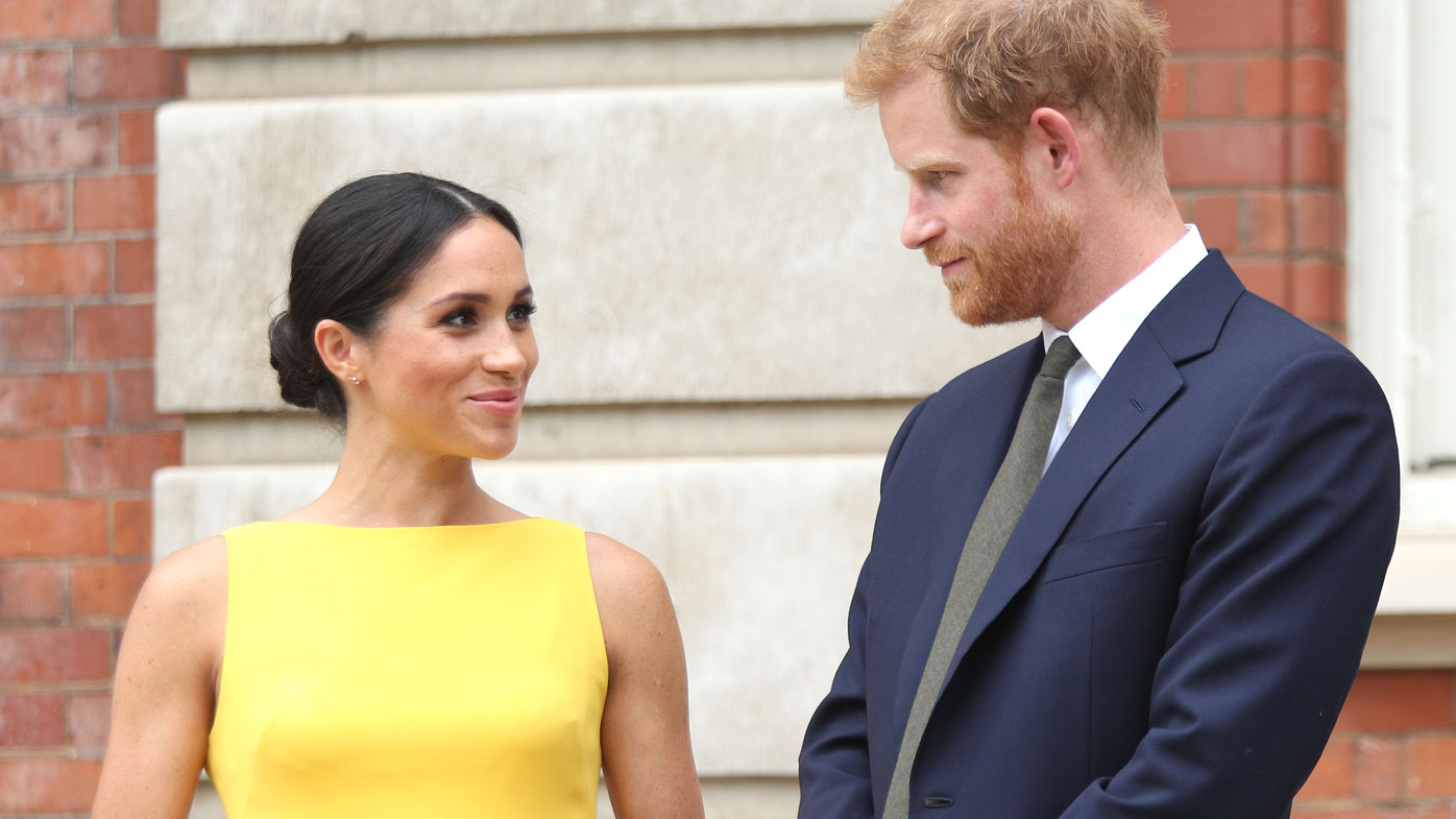 Prince Harry jokingly scolds toddler for touching Meghan's hair