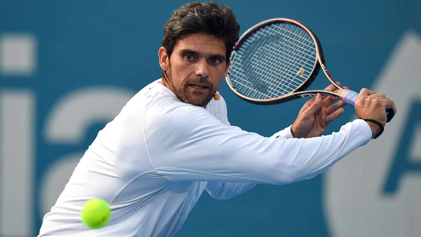 Mark Philippoussis plays a backhand.