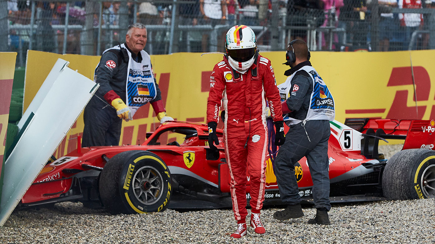 Sebastian Vettel walks away after crashing his Ferrari during the German Grand Prix.
