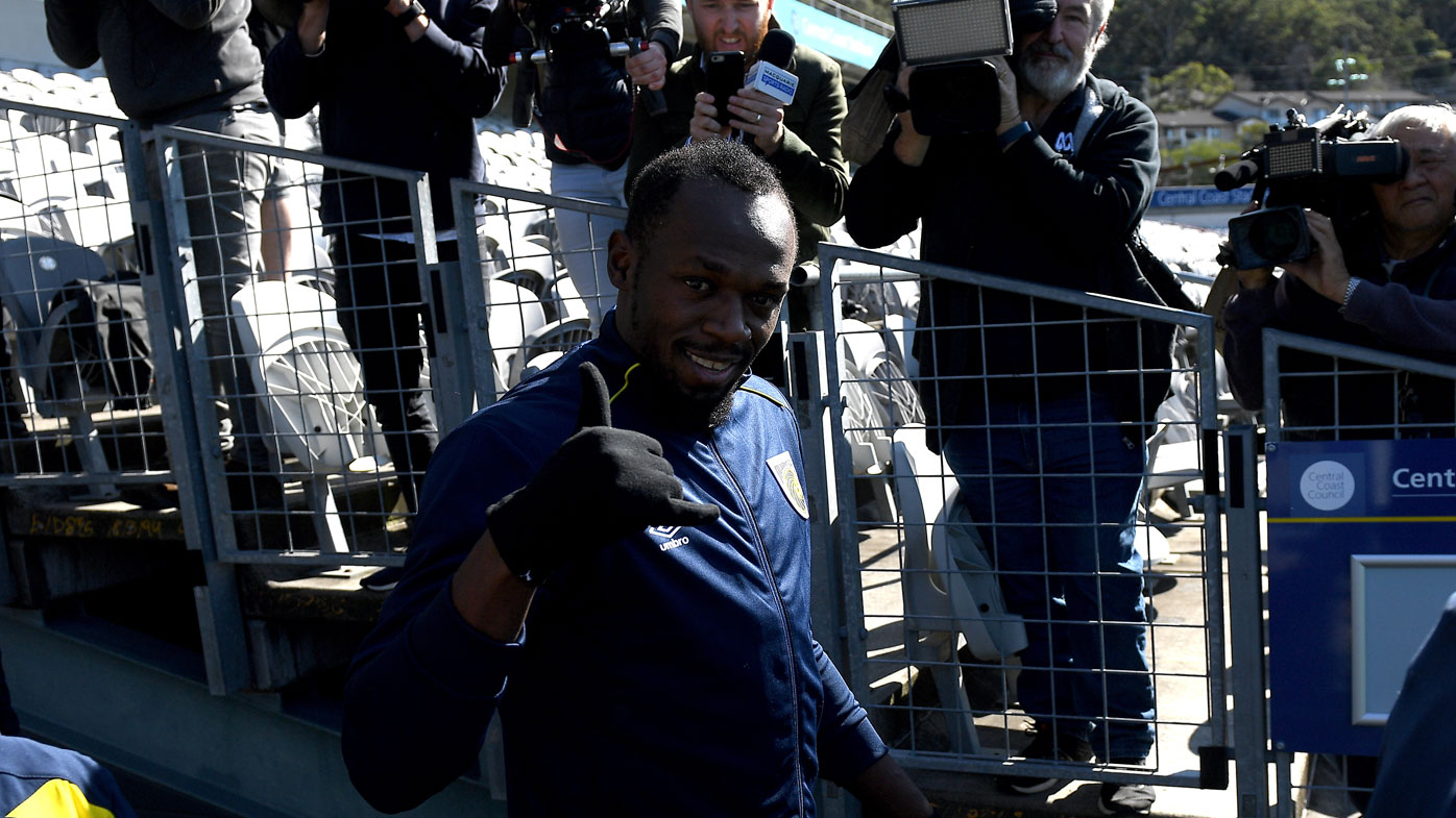 Usain Bolt plays up for the cameras at Mariners training.