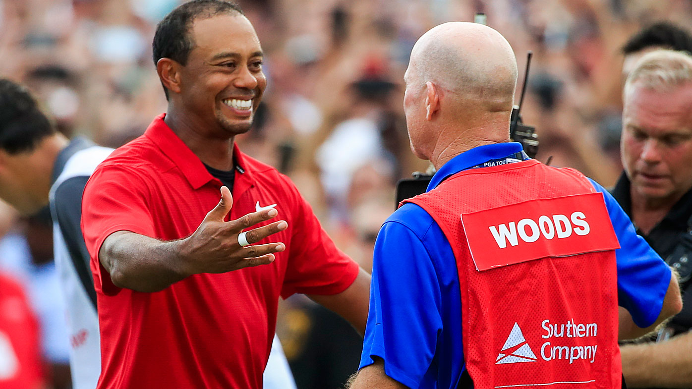 Tiger Woods wins first tournament in 5 years