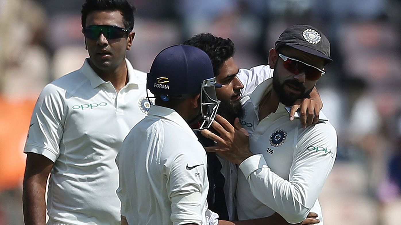 Virat Kohli got a little more than he bargained for as the fan lent in for a cheeky kiss