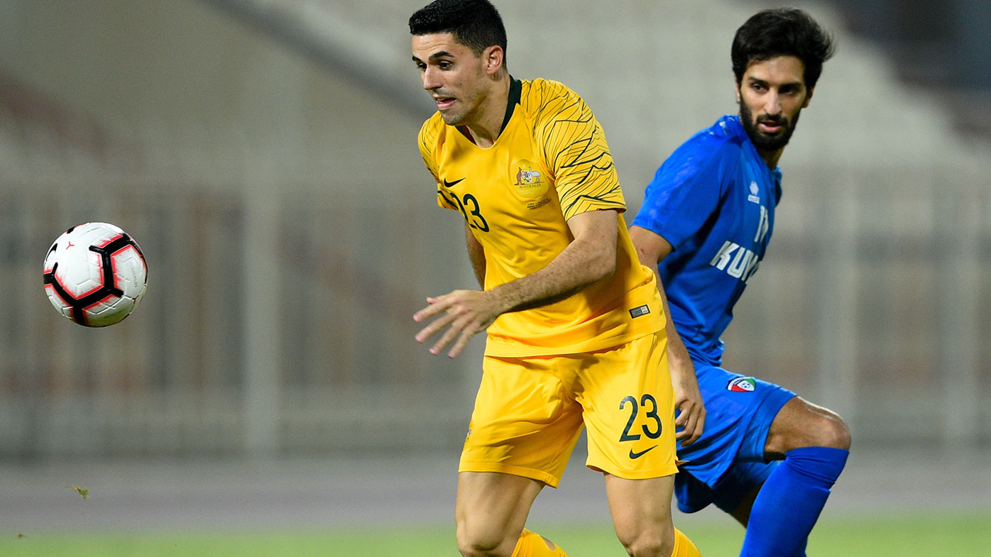 Tom Rogic fights for the ball during Australia's win over Kuwait