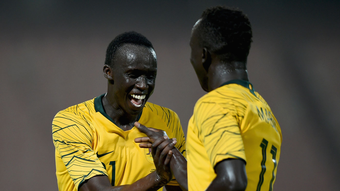 Boyhood mates Thomas Deng and Awer Mabil