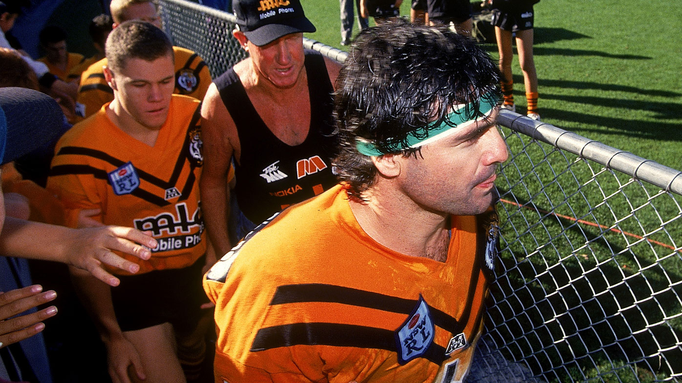 Ben Elias leads out the Balmain Tigers