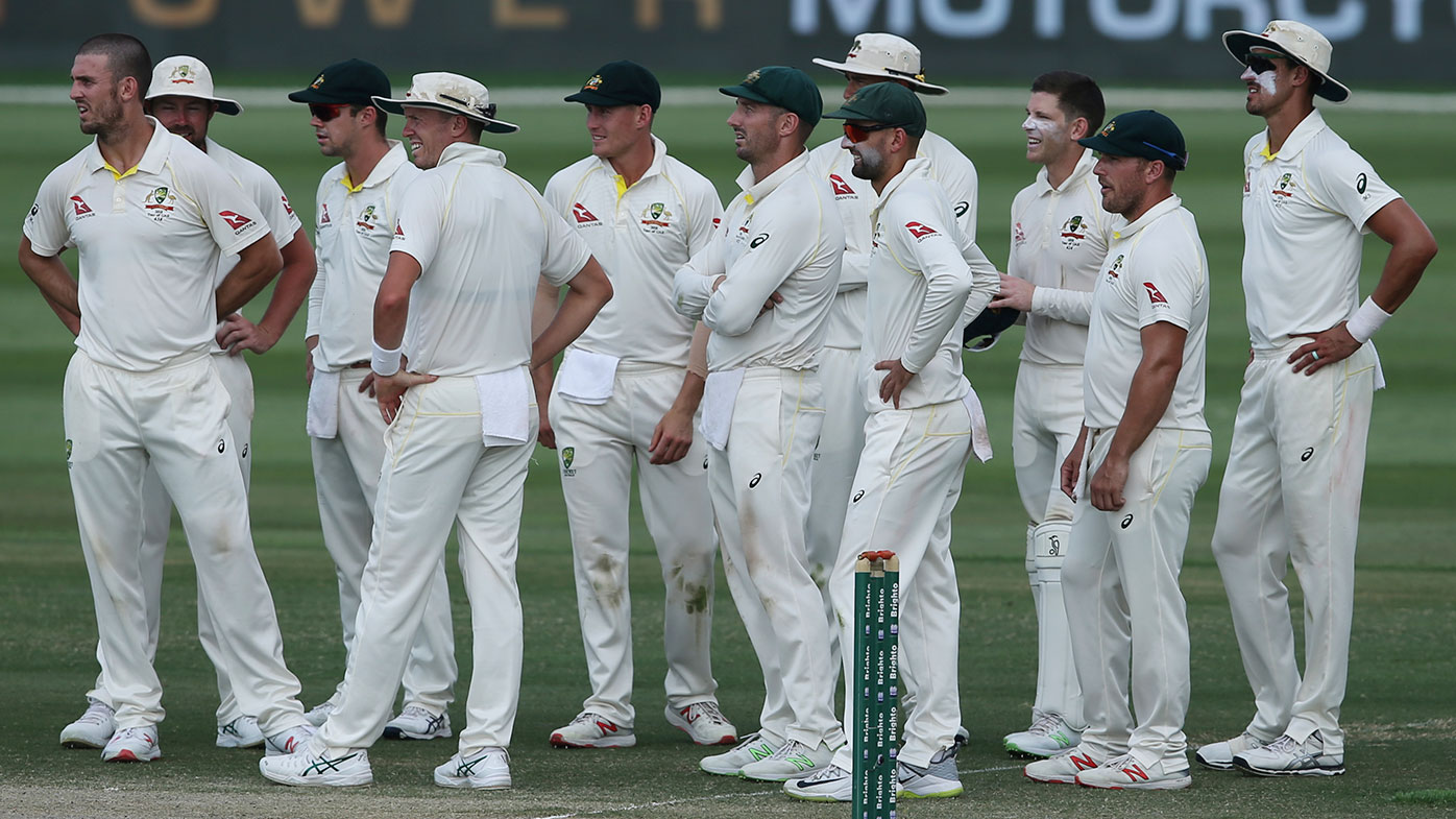 The Australian team await a video review during the second Test against Pakistan