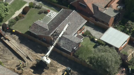 Drill rig topples onto Melbourne home
