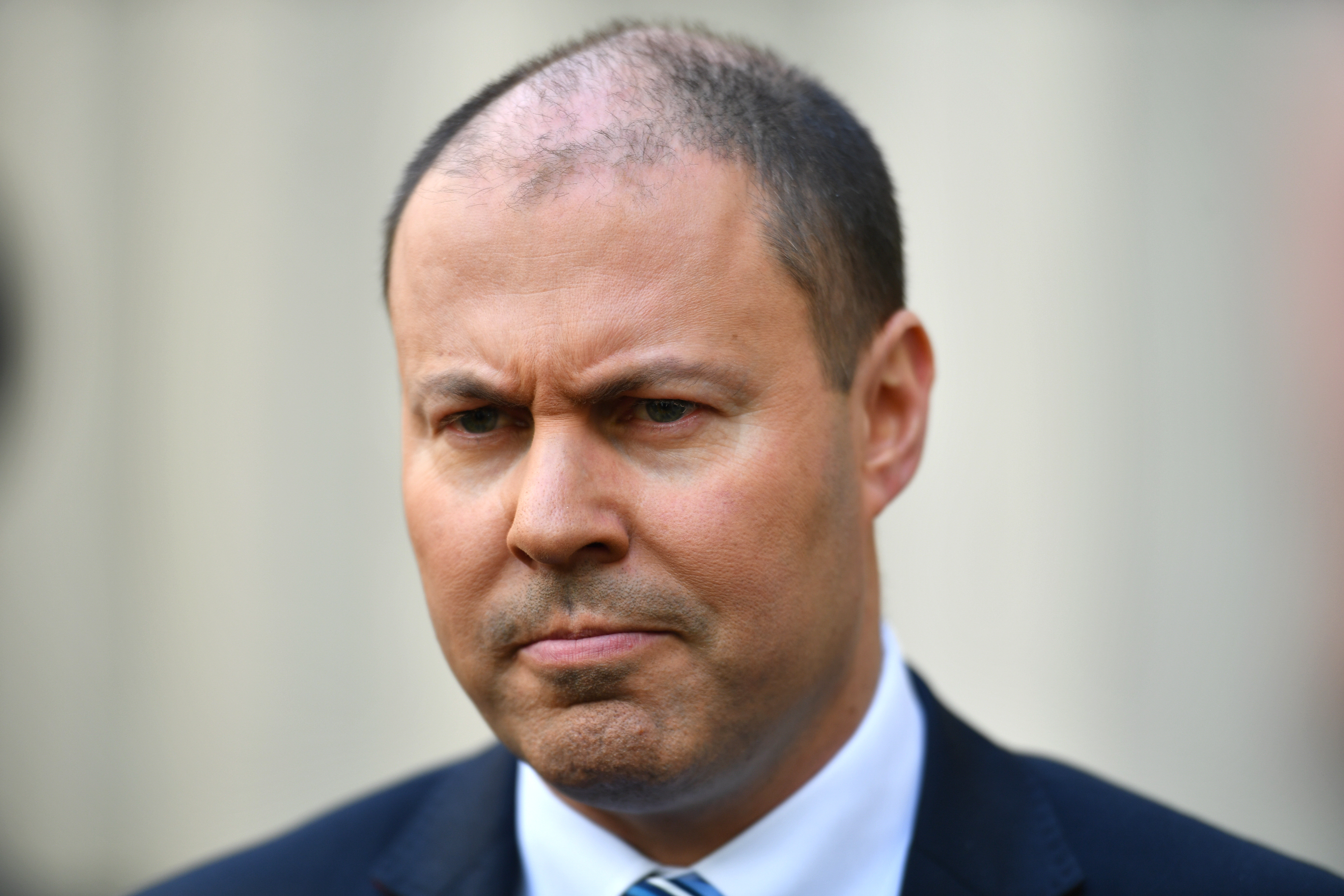 Treasurer slams Labor's $12 billion housing hit