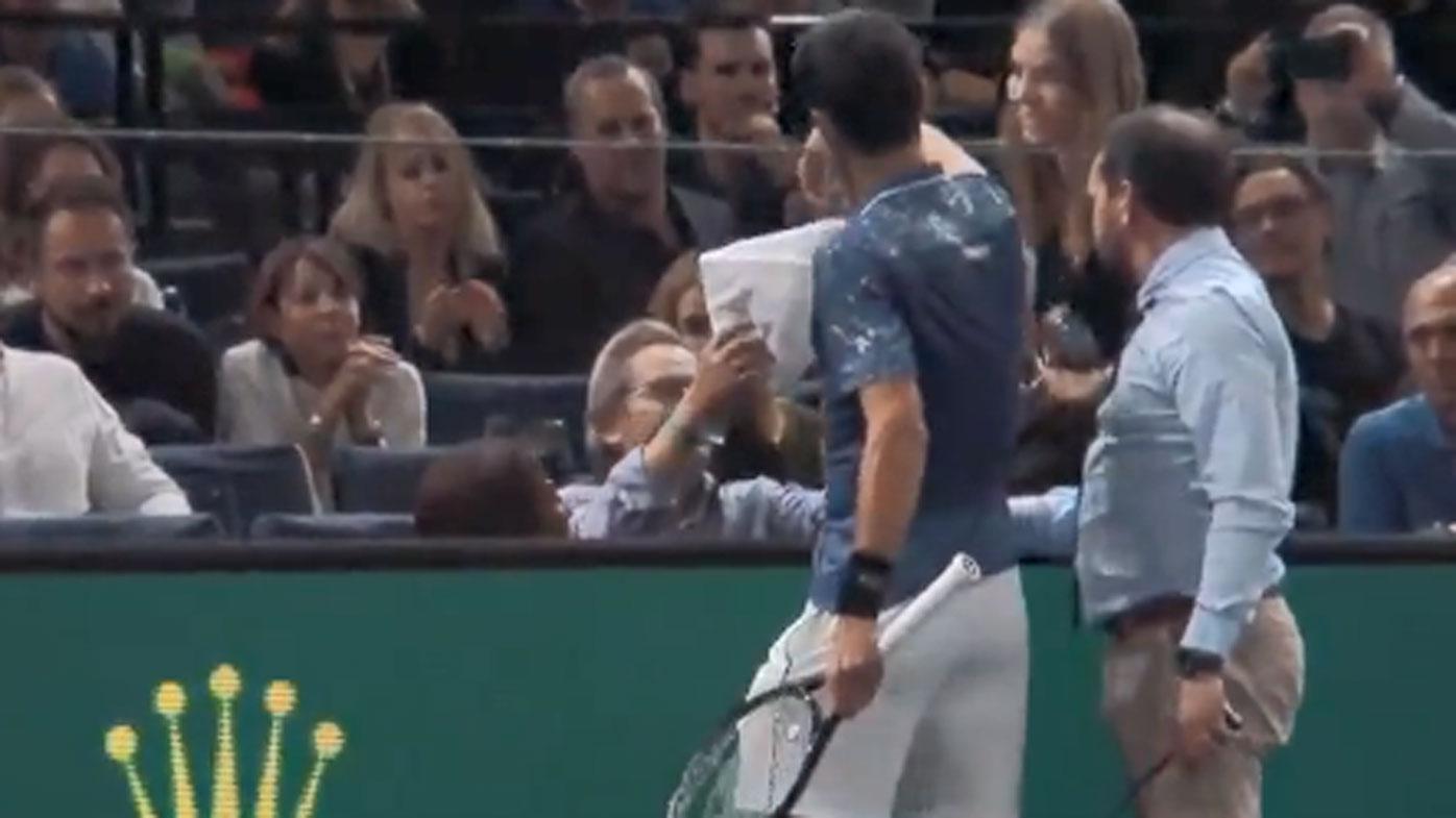 Paris Masters: Roger Federer and Novak Djokovic into quarter-finals