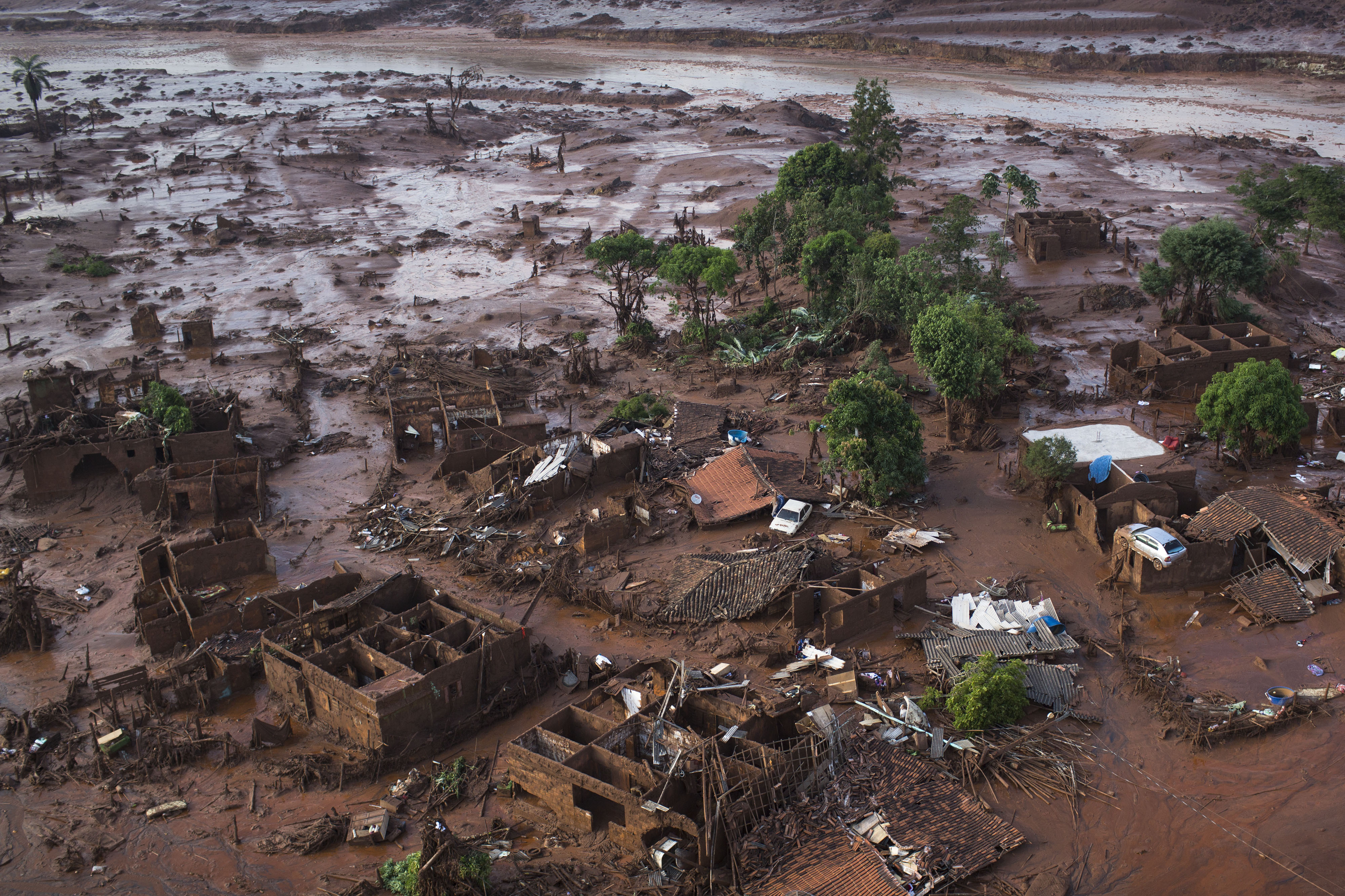 Homes lay in ruins after two dams burst, flooding the small town of Bento Rodrigues in Minas Gerais state, Brazil in 2015.