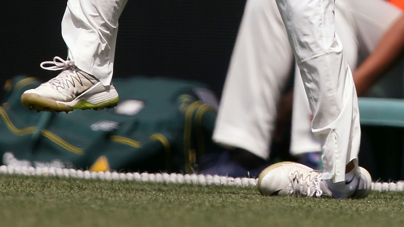 Virat Kohli bowls during India's tour game at the SCG