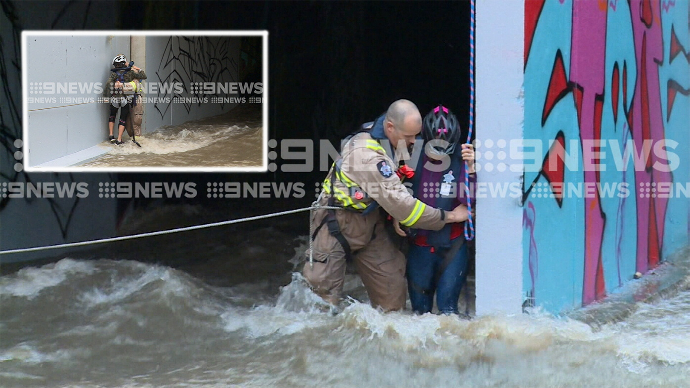 Mother and daughters rescued from flooded tunnel