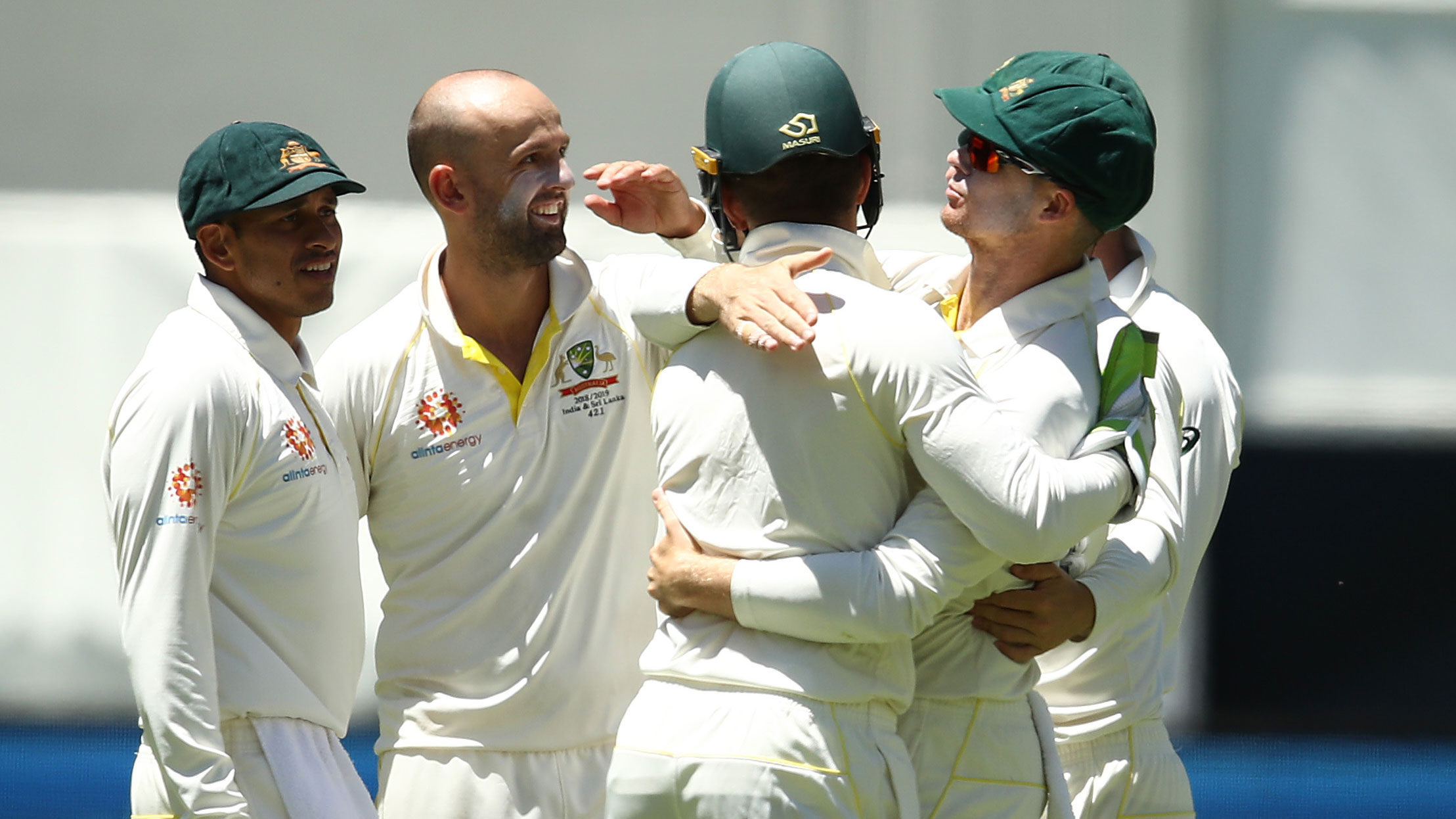 Peter Handscomb celebrates a Nathan Lyon wicket with teammates.
