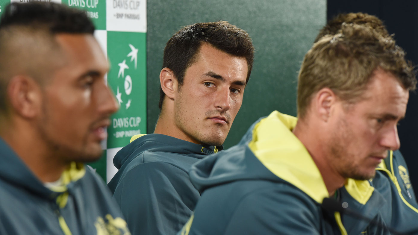 Bernard Tomic ends first clash with Nick Kyrgios with a sneaky serve