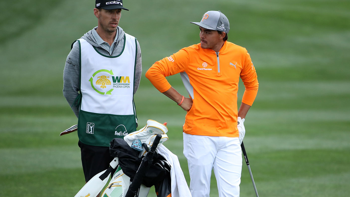 Rickie Fowler and his caddie during the final round of the Phoenix Open.