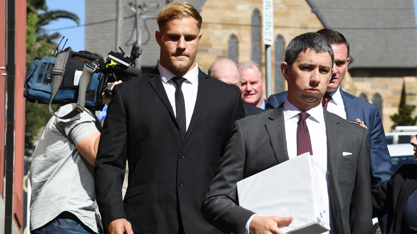 Jack De Belin (middle) has been charged with aggravated sexual assault but has pleaded not guilty.