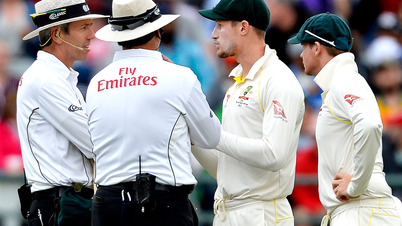 Cameron Bancroft and Steve Smith in discussions with the umpires during the Cape Town Test.