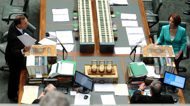 Tony Abbott and Julia Gillard face off in parliament. (AAP)