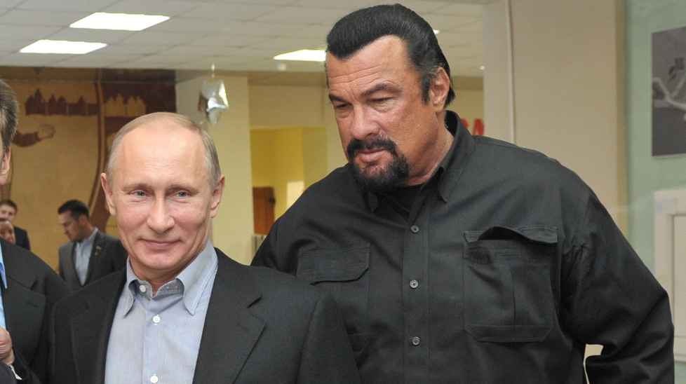 Putin meets US film star Steven Seagal on a visit to a sports complex in Moscow. (Getty)