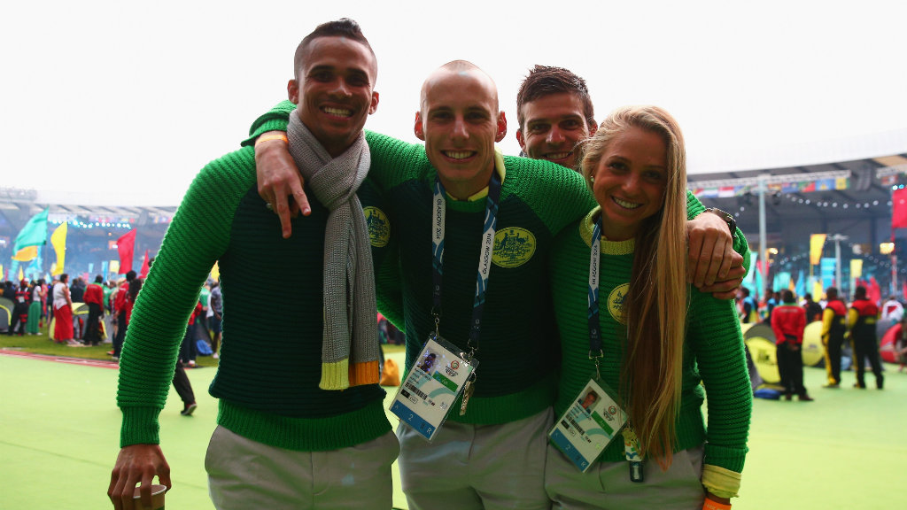 John Steffensen, Ryan Gregson and Genevieve Lacaze of Australia enjoy the atmopshere during the Closing Ceremony for the Glasgow 2014 Commonwealth Games. (Getty)