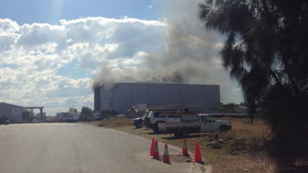 A ship and shed are on fire at a Brisbane shipyard.
