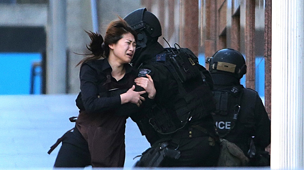 IN PICTURES: Hostages escape from Sydney siege cafe (Gallery)