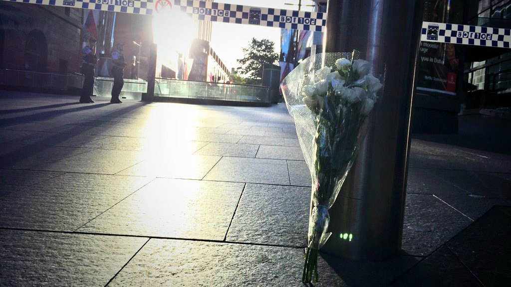 IN PICTURES: Sea of flowers laid in tribute to siege victims in Martin Place (Gallery)